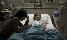 High-angle-view-of-a-girl-lying-on-a-hospital-bed